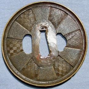 銅石目地四方襷図鍔 盗難品